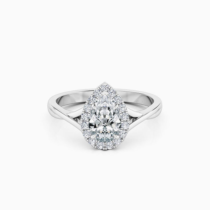Pear cut engagement ring on a twisted plain band