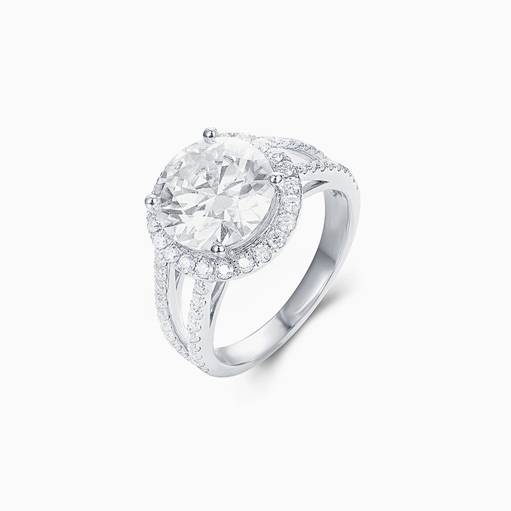 Round Brilliant cut with a diamond halo on a split band Enagement ring