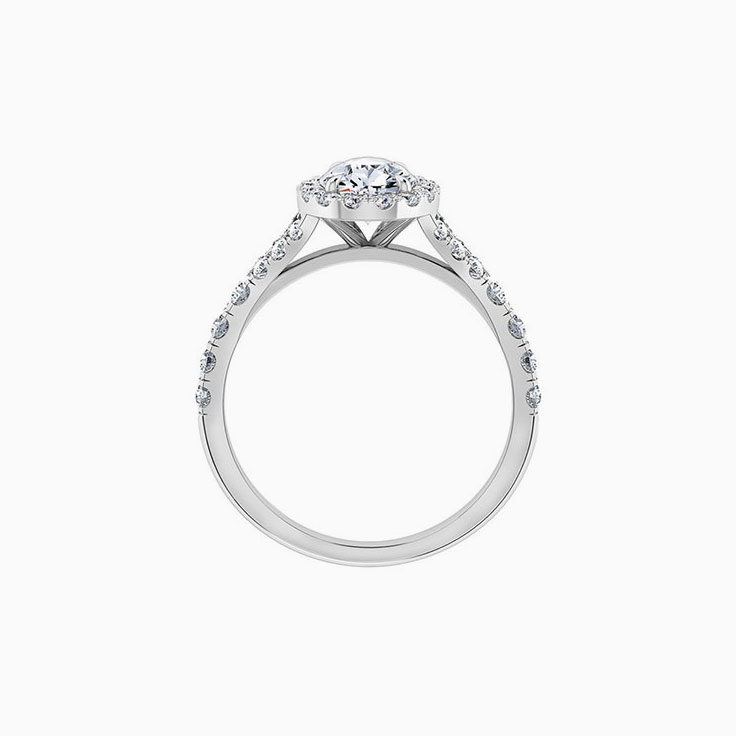 Pear cut daimond with halo and spilt diamond band